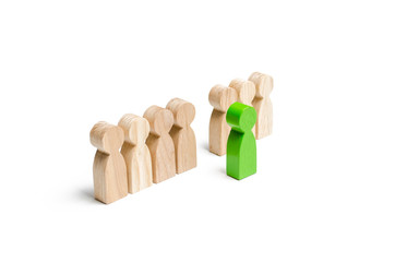 The green figure of a man comes out of the line of people. concept of success and improvement in work, the universal recognition of efficiency and leadership qualities. Talent, leader, professional