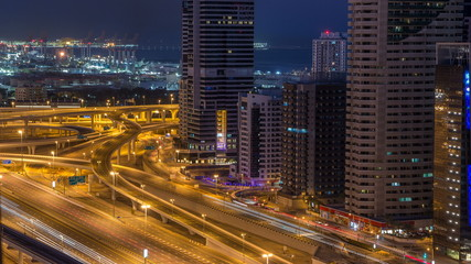 Dubai Marina skyscrapers aerial top view before sunrise from JLT in Dubai night to day timelapse, UAE.
