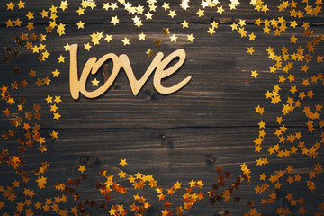 frame of stars on wooden background, word of love