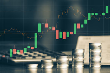 Stock market or forex trading graph with stack of money coin ,financial investment concept use for background