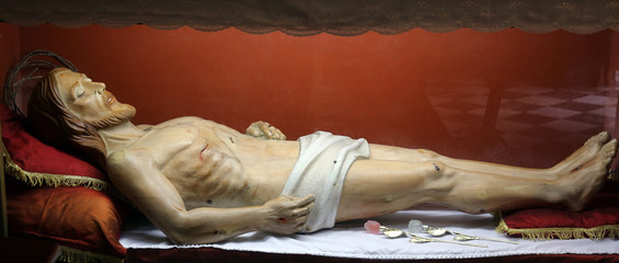 Statue of Jesus Christ in the tomb in the Church of the Holy Sacrament in Portoferraio, Elba, Italy