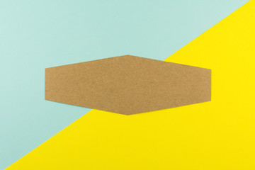 Hexagon brown paper on blue and yellow paper background. - space for your text