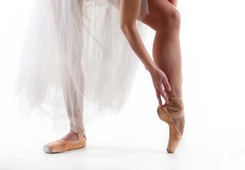 Legs of a professional ballerina in a photo studio.
