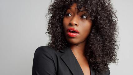 black businesswoman wondering looking aside
