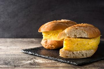 Bocadillo de tortilla española. Spanish potato omelette sandwich on slate background. Copyspace