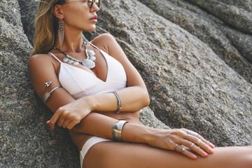 Model in white bikini and wearing boho jewellery Wall mural