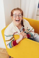 Young woman laughing at camera