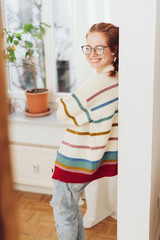 Cute relaxed young woman in a colourful sweater