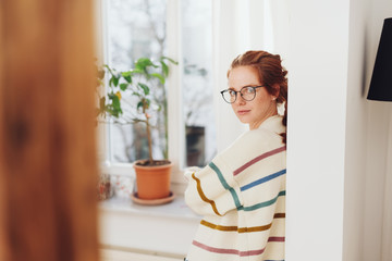 Half-turn portrait of young girl in glasses