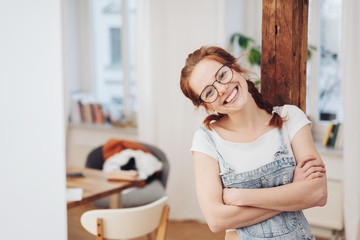 happy confident young woman with folded arms