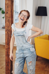 Cute young girl in denim overalls, laughing