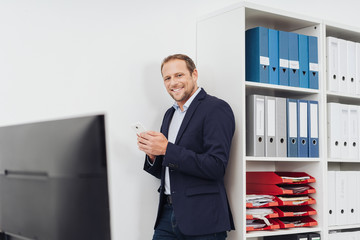 Smart businessman using a mobile in the office
