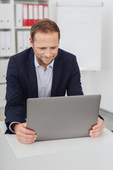 Adult man in business suit looking at tablet