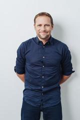 Front portrait of handsome man in blue shirt