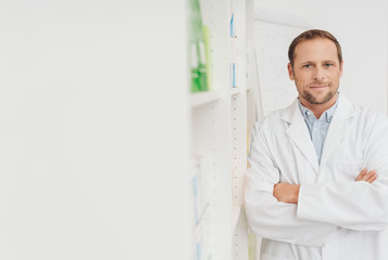 Portrait of a doctor or pharmacist with copy space