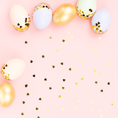 Festive Happy Easter background with decorated eggs, flowers, candy and ribbons in pastel colors on white. Copy space