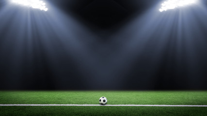 Tradition soccer ball illumintaed by stadium lights