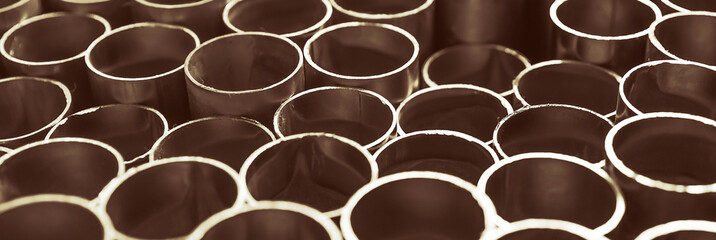 Section of metal pipes. Metallurgical industry concept, background. Texture