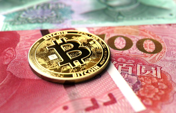 Close-up shot on Bitcoin coin laying on Chinese Yuan bills. Price of Bitcoin in China concept. 3D rendering