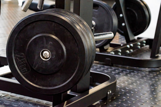 Fitness dumbbell and barbell weight plates in gym close