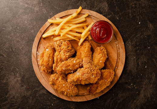 Fried in breaded chicken wings and french fries