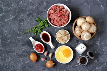 ngredients for cooking meatloaf: minced meat, mushrooms, egg, white bread, onion, garlic, tomato paste, soy sauce, salt, pepper.