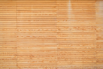 The texture of the wall is covered with wood. Treated tree. Repairs. Frame construction material. Thin covering board. Lining. Natural wood.