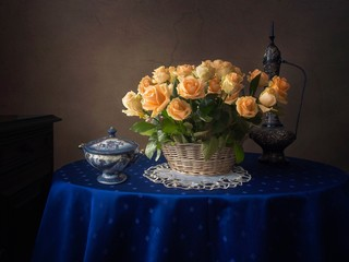 Still life with splendid bouquet of yellow roses