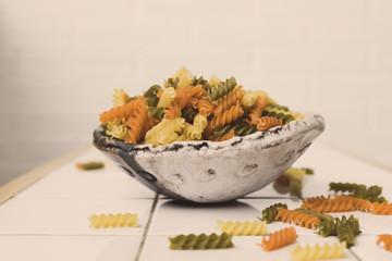 rustic bowl full of organic colored pasta