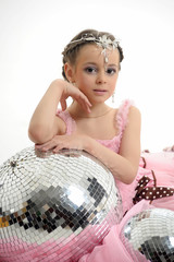 girl in the studio in a pink dress, mirror balls