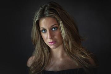 studio portrait of attractive woman