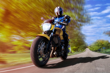 motorcycle riding on highway through countryside. fast motorbike on empty country road rider enjoys freedom