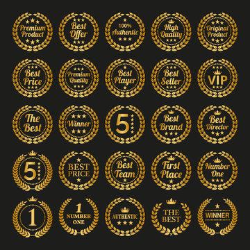 Set of golden laurel wreaths on black background.