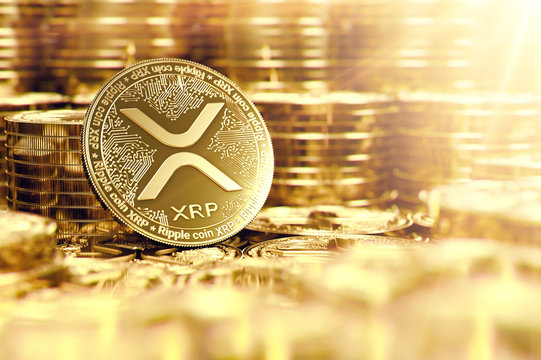Stack of golden Ripple XRP coins in blurry closeup with lens flare as a symbol of prosperity. 3D rendering