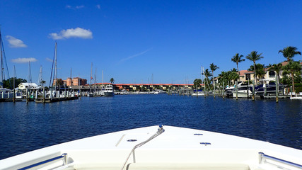 A day boating at a marina in Florida on a beautiful clear blue sky day