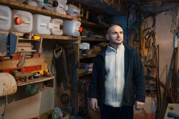 Portrait of pensive adult man in his workshop room