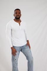 Serious Black man in white shirt