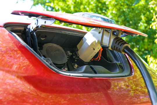 Electric vehicle charging. EV charge port and quick charging socket. Charge port of electric car