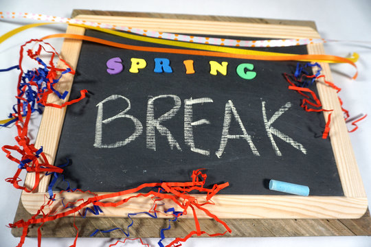 Spring Break message on chalkboard with colorful ribbon and letters