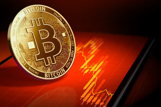 Golden bitcoin standing on a screen with red downtrend diagram. Bitcoin price falling concept. 3D rendering