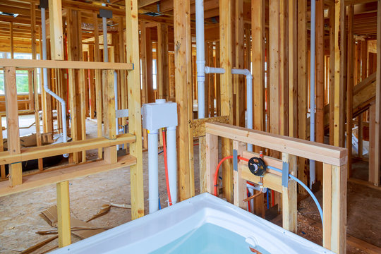 Interior wall framing with piping and bathroom installed