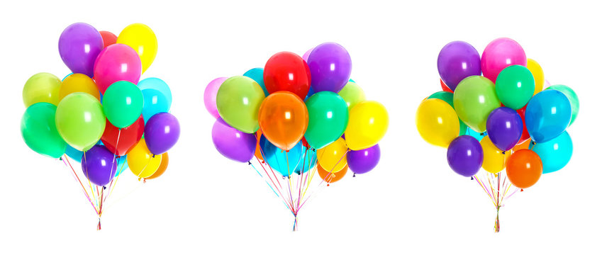 Set of bunches with colorful air balloons on white background