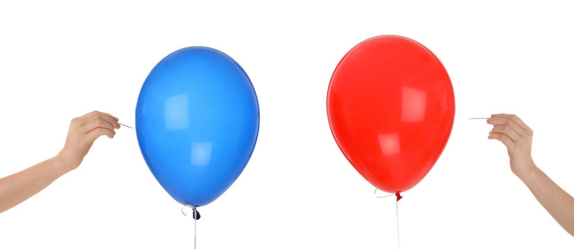 Women piercing colorful balloons on white background