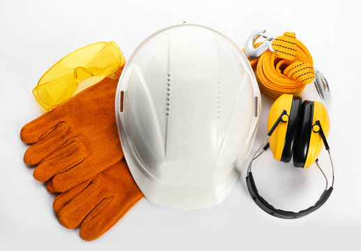 Set of safety equipment on white background, top view