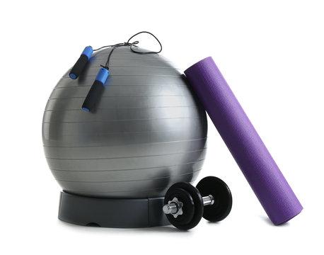 Set of fitness equipment on white background