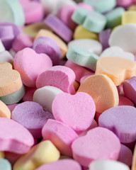 Assortment of candy hearts.  Blurry background.