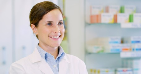 Portrait of a beautiful young woman pharmacist consultant smiling in camera. Concept of profession, medicine and healthcare, medical education, pharmaceutical sector