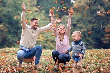 Happy family enjoying in autumn park