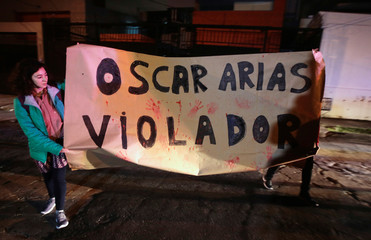People protest against Nobel Peace Prize winner and former Costa Rican president Oscar Arias, who was accused of sexual assault by a doctor, outside his house in San Jose
