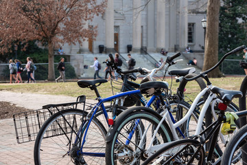 A bike rack on a college campus in the Spring